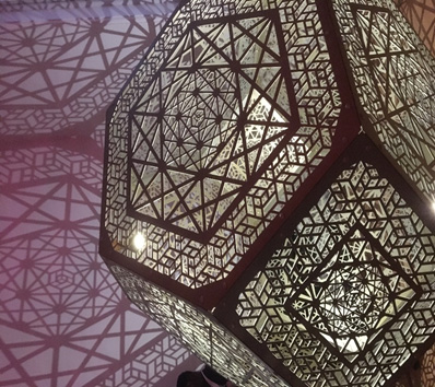 Intricate 3D structure, illuminated and casting a shadow